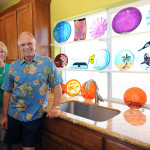 Glass artist Lynn Anderson, right, stands with his wife, Marilyn in his studio in Cameron Park. Lynn's art and garden will be open during the Assistance League of Sierra Foothills' Gardens of the Hills tour May 4 & 5. Village Life photo by Shelly Thorene
