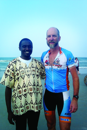 Lee Wiegand, right, stands with Ride For Hope Tanzania Director Assed in Daytona Beach, the end of the 2011 Ride for Hope. Courtesy photo