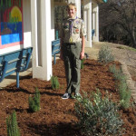 Boy Scout Owen Lundell stands in his finished Eagle Scout project area at Marina Village. Courtesy photo