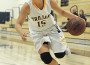 Lady Trojan Jenn Hoffman gets ready to drive in the ball during Saturday's Shootout. Village Life photo by Pat Dollins