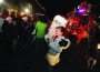 Olicia Flaherty, 6, of El Dorado Hills gets a hug from Santa on the last night of the 2012 El Dorado Hills Santa Run. Village Life photo by Krysten Kellum