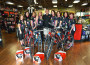 Bodacious Biking Babes Carrie Cain, Kathy Hurd, Kim Fish, Colleen Yeandle-Rich, team sponsor John Crews, Cindy Freeman, Michele Ruscito, Pauline Curtis and Lisa Robbins, left to right, donated bikes and safety gear to women who need reliable transportation. Courtesy photo