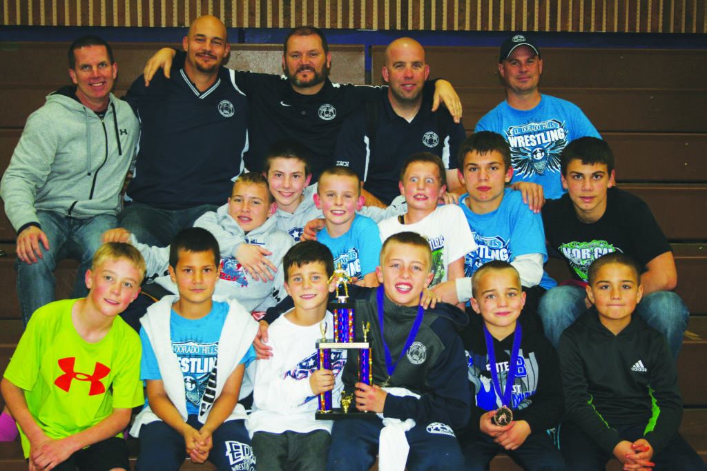 EDH club wrestlers and coaches celebrate the team's second place finish at the NOR-CAL 12 & Under Wrestling Championships earlier this month. Courtesy photo