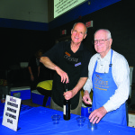 Auditor-Controller Joe Harn, left, put down his calculator and picked up a corkscrew to help serve wine, beer and more with pal Art Patterson. Motherlode Rehabilitation Enterprises set up and staffed the crab feed bar.