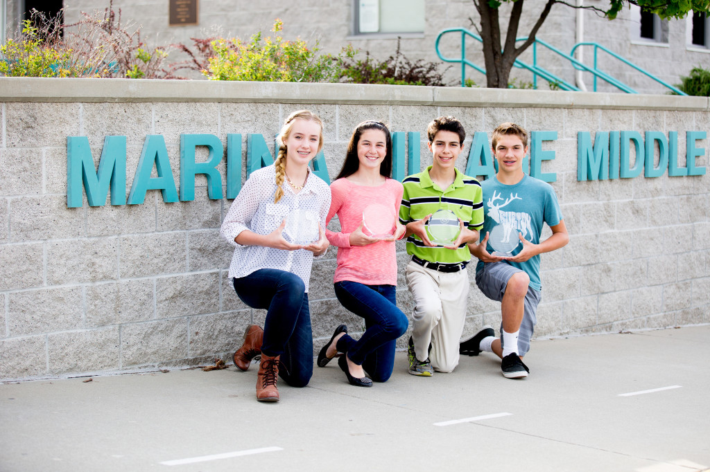 The first Mustang Pride recipients are graduating eighth-graders Sarah Lundell, Emily Bobrowsky, Tyler Barth and Brycen Groess, left to right. The award recognizes outstanding scholarship, service and commitment. Photo by Diane Orciuoli