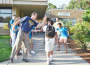 Principal Paul Burke and student greeters welcome each student back to school Monday. Village Life photo by Julie Samrick