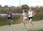 Lady Trojans' Haley Dean, middle, and Mikhayla Polivka, right, compete at Saturday's Bronco Invite. Photo by Mike Bush