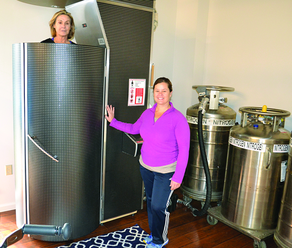 Jeanette Panzer, left, goes in for an advanced cryotherapy therapy session at NorCal Cryotherapy in El Dorado Hills Town Center. Owner Sharon Thompson discusses the many benefits of the two-minute session with all new clients. Photo by Julie Samrick