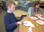 Fourth grader Luke Gaal and third grader Sadie Erickson concentrate on painting clay art work in preparation for Oak Meadow's annual Art Walk Feb. 18. The event is free and open to the public. Village Life photo by Julie Samrick