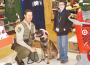 Department of Fish and Wildlife Warden Brian Patrick introduces Karma, a Belgium Malinois K-9, to William, 9. Children enjoyed meeting law enforcement service dogs while participating in the Snowball shopping spree at Target Saturday. Photo by Laurie Edwards.